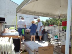 Volunteers cooked the donated food that was on sale.